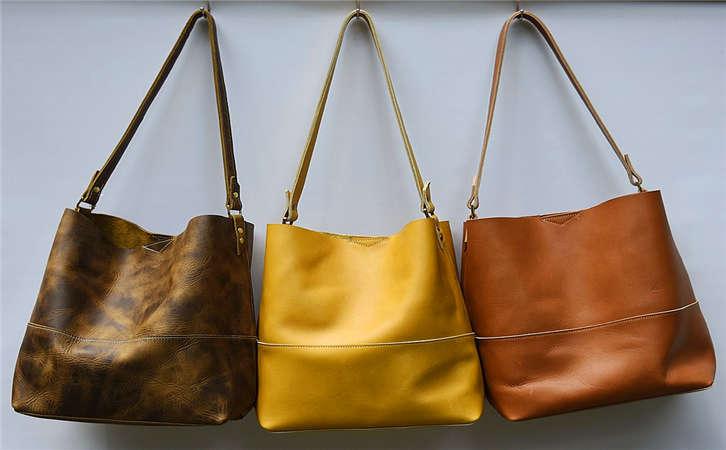 2021夏季欧洲新款真皮高端箱包便宜尾单好货,广州十三行包包批发