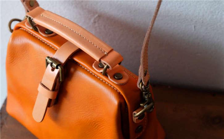 工厂直销跨境皮具欧美十大品牌,包包扣批发价格